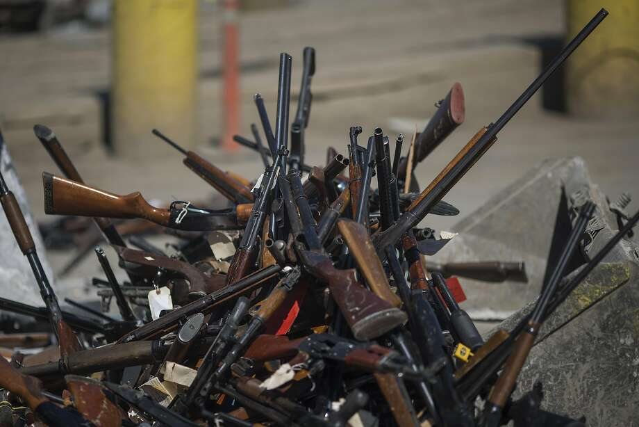 RANCHO CUCAMONGA, CA - JULY 21: Guns are scooped up between two front loader tractors as a record 7,044 guns are destroyed by the Los Angles County Sheriffs Department at the Gerdau Steel Mill during 23rd annual Gun Melt on July 21, 2016 in Rancho Cucamonga, California. The weapons, seized in criminal investigations, probation seizures and gun buyback events, will be recycled into steel rebar for the construction of local highways and bridges. (Photo by David McNew/Getty Images) Photo: David McNew, Getty Images