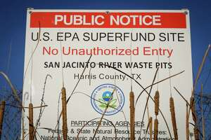 A sign warns the public about the EPA Superfund Site and not to eat contaminated seafood caught from the water along Interstate 10 near the San Jacinto River east of Houston in Channelview.  (Chronicle file photo)