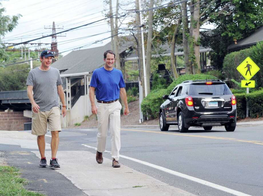U.S. Senator Chris Murphy (D-Conn.), left, walks with U.S. Representative Jim Himes (CT-4) on West Avenue before entering Tilley Pond Park, Darien, Conn., Friday night, Sept. 2, 2016. Senator Murphy held a town meeting in the park that is part  of a 120-mile walk across Connecticut to listen to and get feedback from residents. Murphy was joined by Congressman Himes for the Norwalk to Darien leg of the trek. Senator Murphy started his walk on Monday in Voluntown, on the Rhode Island border, and is scheduled to conclude his journey Saturday morning in Greenwich. Photo: Bob Luckey Jr. / Hearst Connecticut Media / Greenwich Time