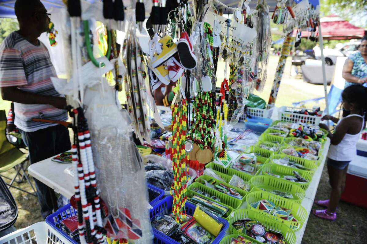 Guyanese children look over items for sale at a booth at the Guyanese Fun Day at Grout Park on Sunday, Sept. 6, 2015, in Schenectady, N.Y. (Paul Buckowski / Times Union)