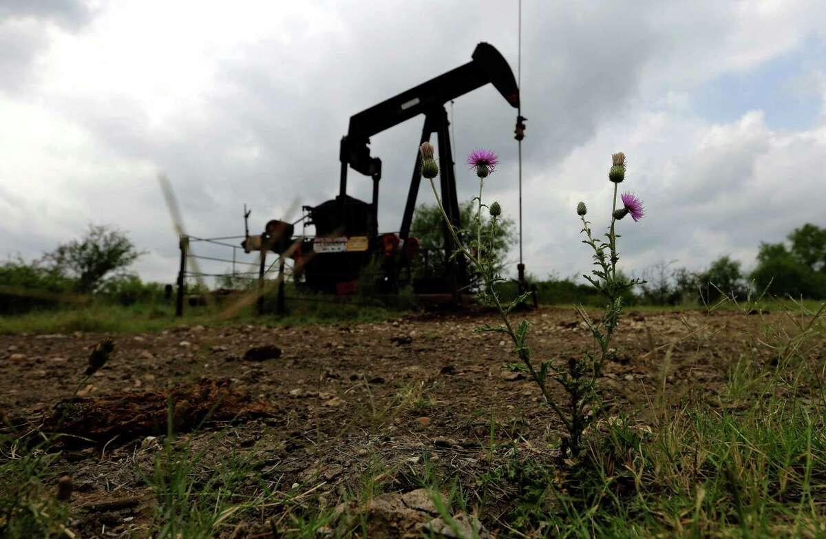 A shorthanded Railroad Commission and an outdated computer system have created a massive safety backlog. In this Friday, May 13, 2016, photo, a pump jack sits idle on a South Texas ranch near Bigfoot, Texas. The