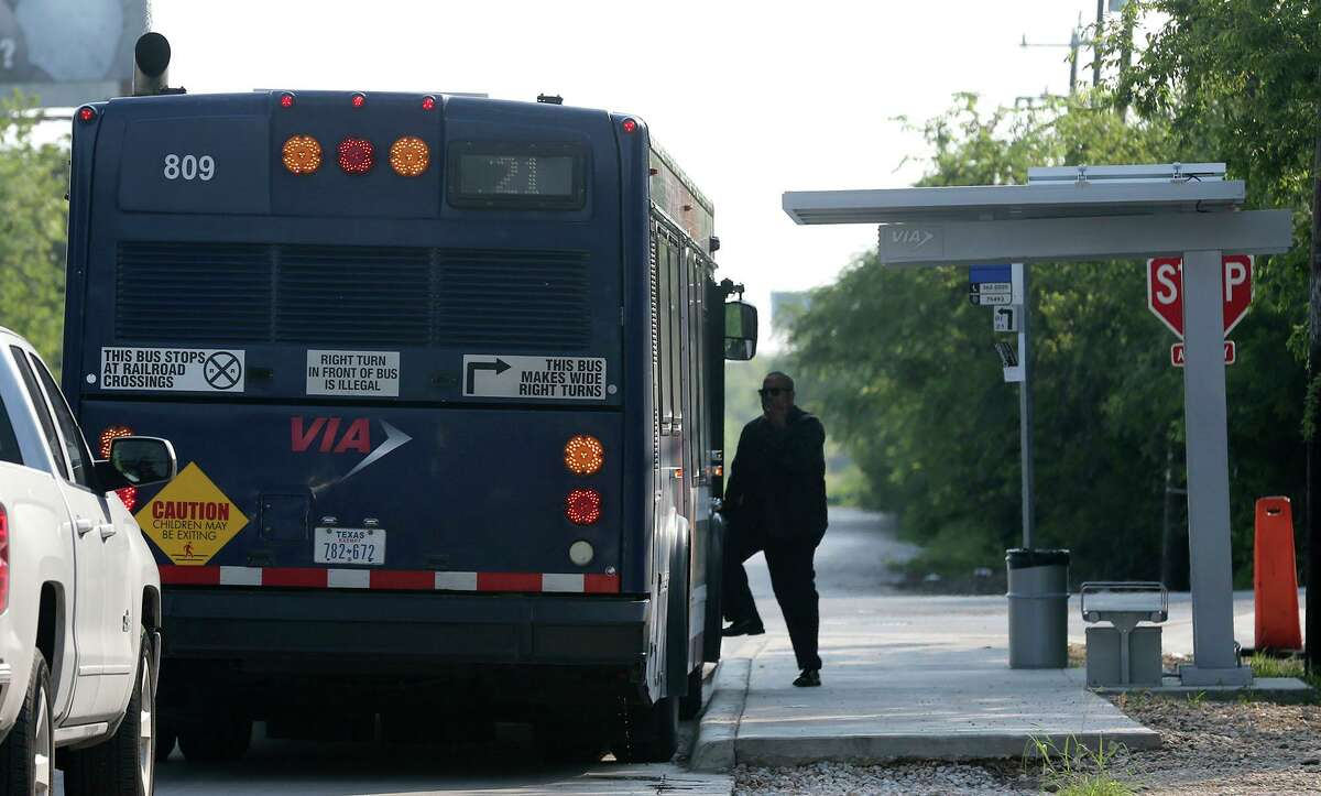 FILE: A pedestrian boards a VIA bus on Old Seguin Road in Kirby.