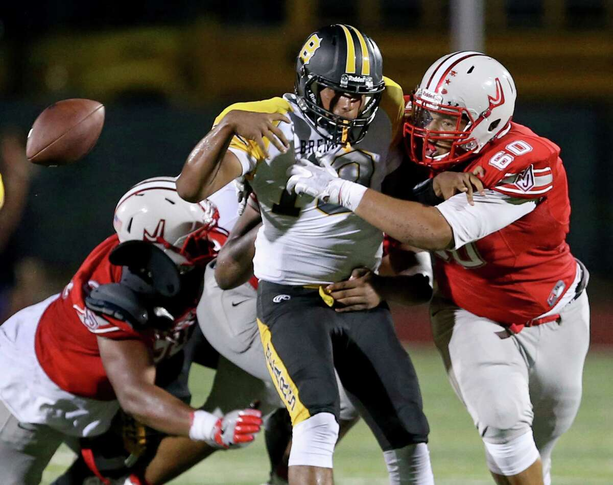 Friday Sept. 2, 2016 Rutledge StadiumJudson 55vs.Brennan 13Brennan's Jordan Martinez fumbles the ball as he is hit by Judson's Darren Brown and other defenders during first half action Friday Sept. 2, 2016 at Rutledge Stadium.
