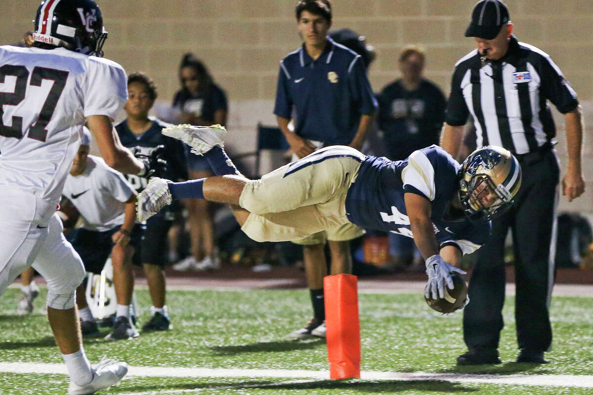 O'Connor's Shawn Jasso leaps across the goal line on a 6-yard touchdown reception during the first half of their game with Churchill at Farris Stadium on Friday, Sept. 2, 2016. MARVIN PFEIFFER/ mpfeiffer@express-news.net