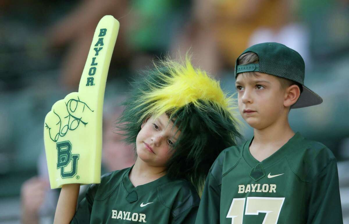 Young Baylor fans stand in the stands during the first half of an NCAA college football game Friday, Sept. 2, 2016, in Waco, Texas. (AP Photo/LM Otero)