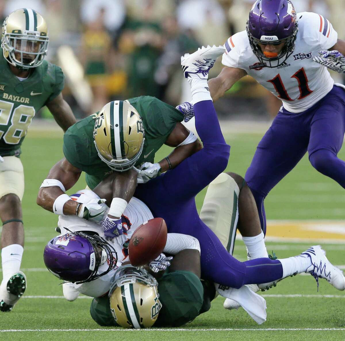 Northwestern State running back De'Mard Llorens (25) fumbles the ball during the first half of an NCAA college football game against Baylor Friday, Sept. 2, 2016, in Waco, Texas. (AP Photo/LM Otero)