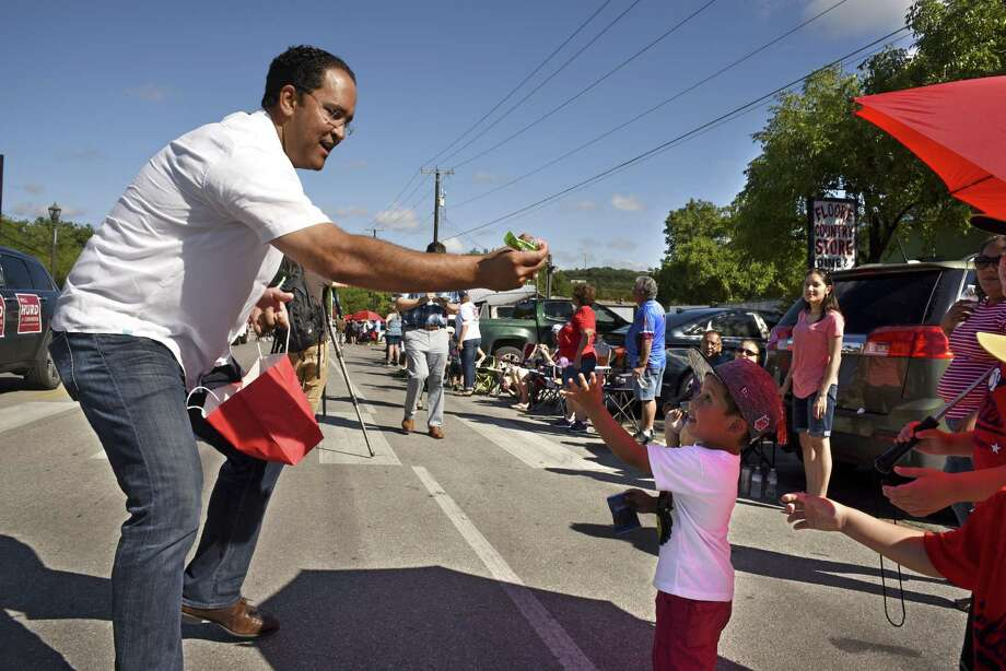 In this file photo, U.S. Rep. Will Hurd, who is running for re-election in the Texas' 23rd Congressional District race, greets bystanders in Helotes during a parade honoring the members of the 2016 Little League World Series softball championship team. Photo: Billy Calzada /San Antonio Express-News / San Antonio Express-News