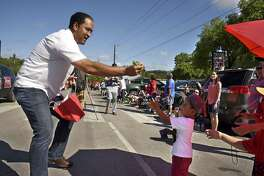 In this file photo, U.S. Rep. Will Hurd, who is running for re-election in the Texas' 23rd Congressional District race, greets bystanders in Helotes during a parade honoring the members of the 2016 Little League World Series softball championship team.