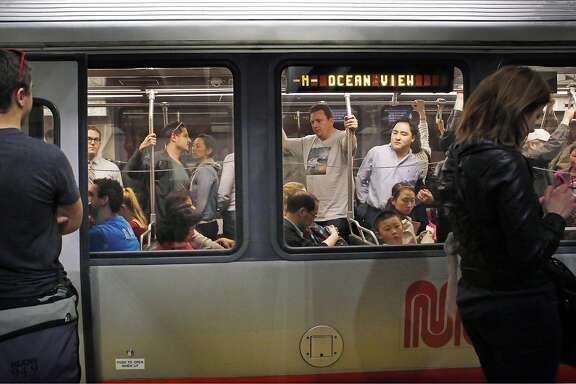During the Friday evening commute, MUNI riders pack and inbound  train on Friday Feb. 13, 2015 in San Francisco, Calf.