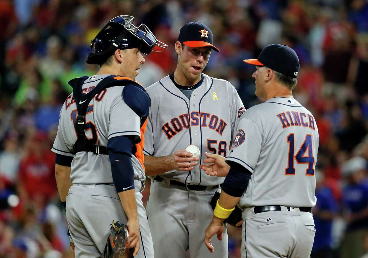 Sept. 2: Rangers 10, Astros 8 Houston Astros' Jason Castro stands on the mound as Doug Fister (58) turns the ball over to manager A.J. Hinch (14) in the fourth inning of a baseball game against the Texas Rangers, Friday, Sept. 2, 2016, in Arlington, Texas. (AP Photo/Tony Gutierrez)