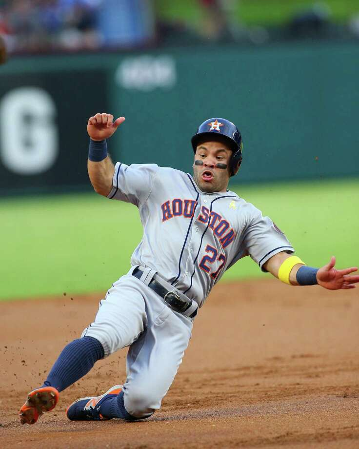 ARLINGTON, TX - AUGUST 28: Jose Altuve #27 of the Houston Astros slides in safe at third base in the first inning against the Texas Rangers at Globe Life Park in Arlington on August 28, 2016 in Arlington, Texas. Photo: Rick Yeatts, Getty Images / 2016 Getty Images