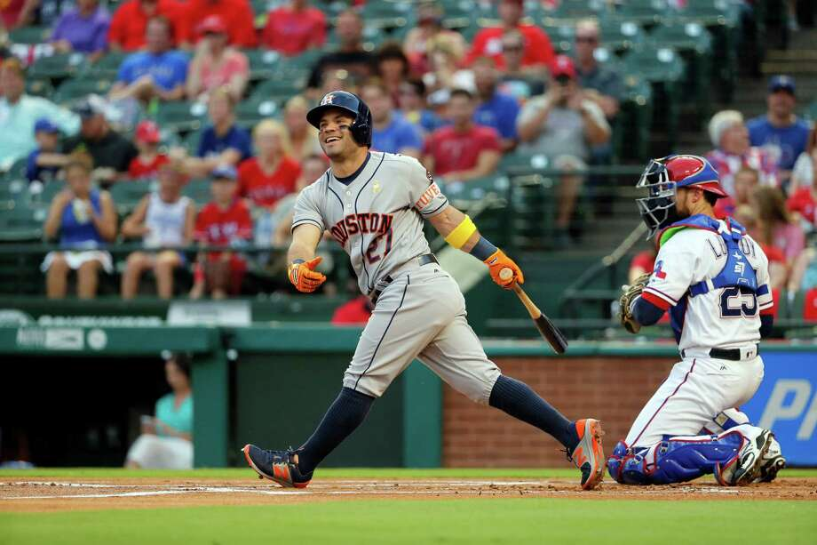 Houston Astros' Jose Altuve smiles after swinging at a pitch from Texas Rangers starting pitcher A.J. Griffin as catcher Jonathan Lucroy watches in the first inning of a baseball game, Friday, Sept. 2, 2016, in Arlington, Texas. (AP Photo/Tony Gutierrez) Photo: Tony Gutierrez, Associated Press / AP