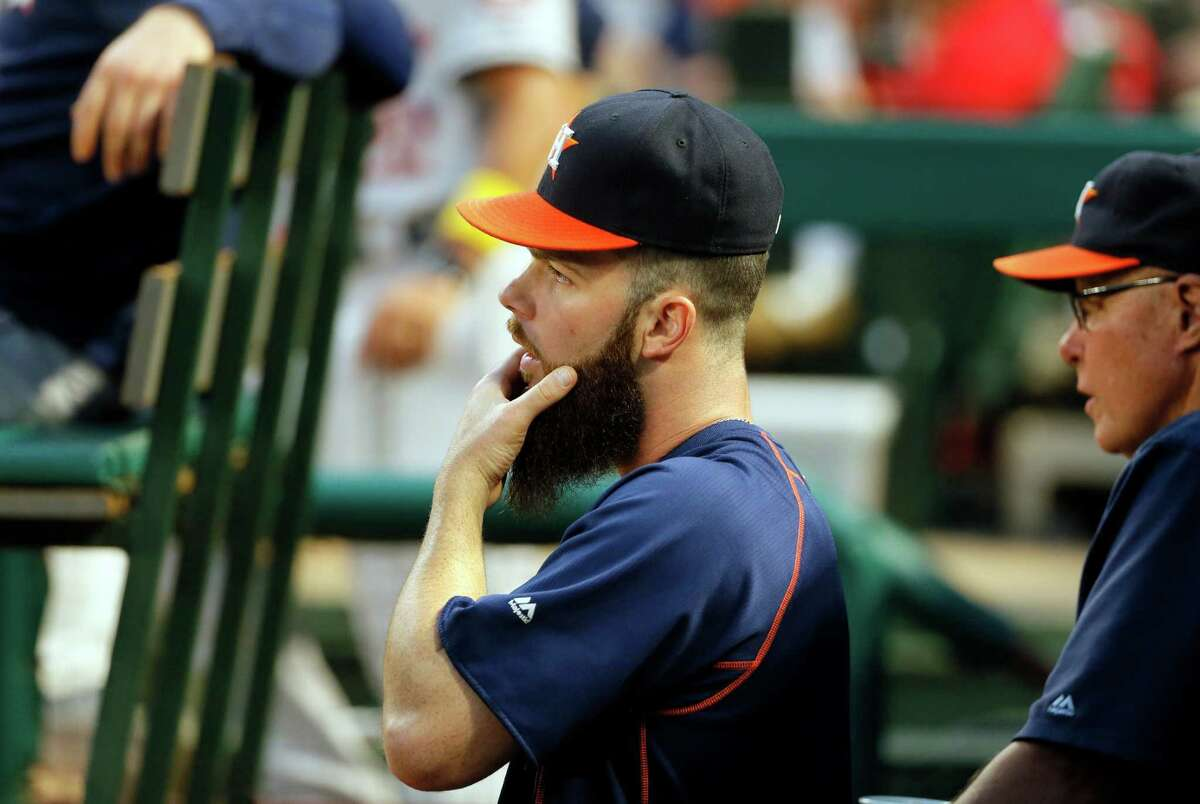 Houston Astros starting pitcher Dallas Keuchel stands in the dugout watching play against the Texas Rangers in the second inning of a baseball game, Friday, Sept. 2, 2016, in Arlington, Texas. (AP Photo/Tony Gutierrez)