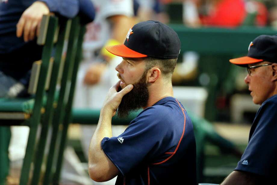 Houston Astros starting pitcher Dallas Keuchel stands in the dugout watching play against the Texas Rangers in the second inning of a baseball game, Friday, Sept. 2, 2016, in Arlington, Texas. (AP Photo/Tony Gutierrez) Photo: Tony Gutierrez, Associated Press / Copyright 2016 The Associated Press. All rights reserved.