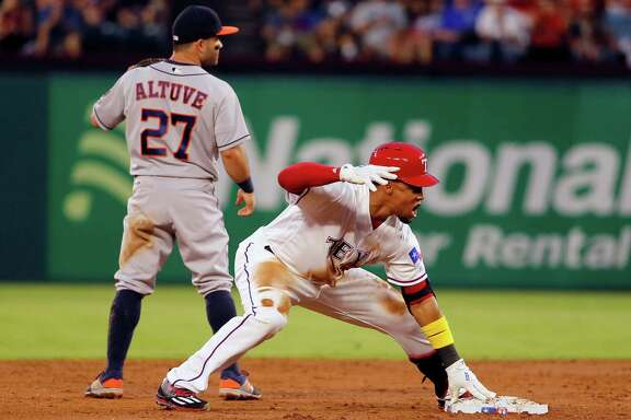 Texas Rangers' Carlos Gomez, right, celebrates his double as Houston Astros second baseman Jose Altuve (27) waits for the throw to the bag in the second inning of a baseball game, Friday, Sept. 2, 2016, in Arlington, Texas. (AP Photo/Tony Gutierrez)