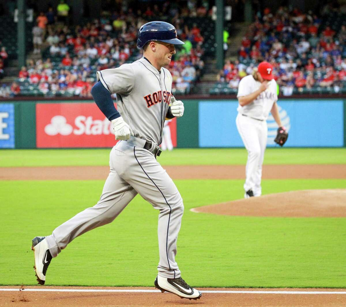 The Houston Astros' Alex Bregman makes his way home after a solo home run in the first inning off of Texas Rangers starting pitcher A.J. Griffin at Globe Life Park in Arlington, Texas, on Friday, Sept. 2, 2016.