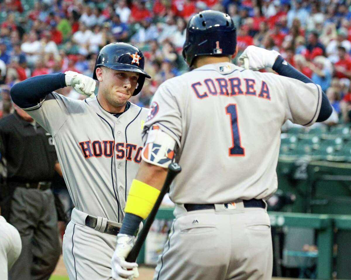 The Houston Astros' Alex Bregman celebrates his first-inning solo home run with Carlos Correa (1) against the Texas Rangers at Globe Life Park in Arlington, Texas, on Friday, Sept. 2, 2016.
