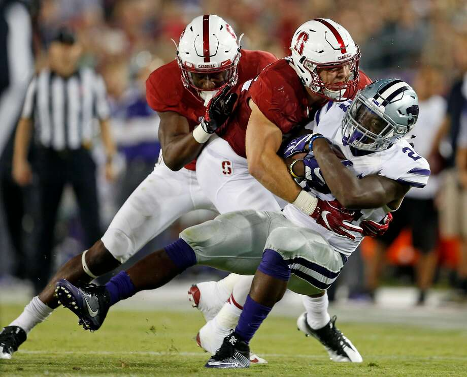Stanford's Joey Alfieri tackles Kansas State's Charles Jones in 3rd quarter during college football game in Stanford, Calif., on Friday, September 2, 2016. Photo: Scott Strazzante, The Chronicle