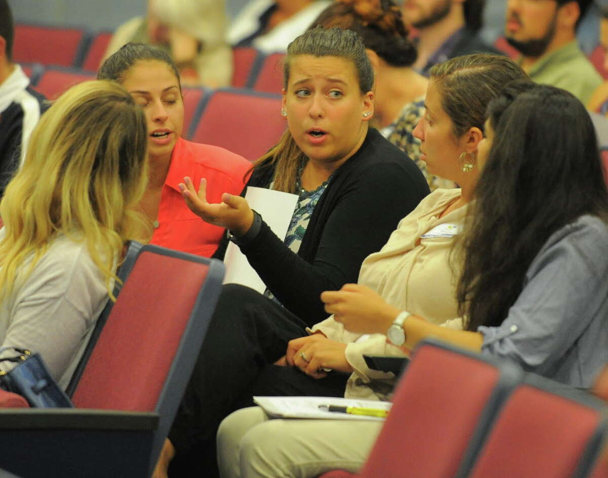 Alyssa Bogdanowicz, center, a Special Education teacher with the New School on Strawberry Hill Avenue in Stamford, Conn. chats with fellow teachers and staff during day 2 of Stamford Public Schools New Teacher and Staff Orientation on Friday, Aug. 26, 2016.