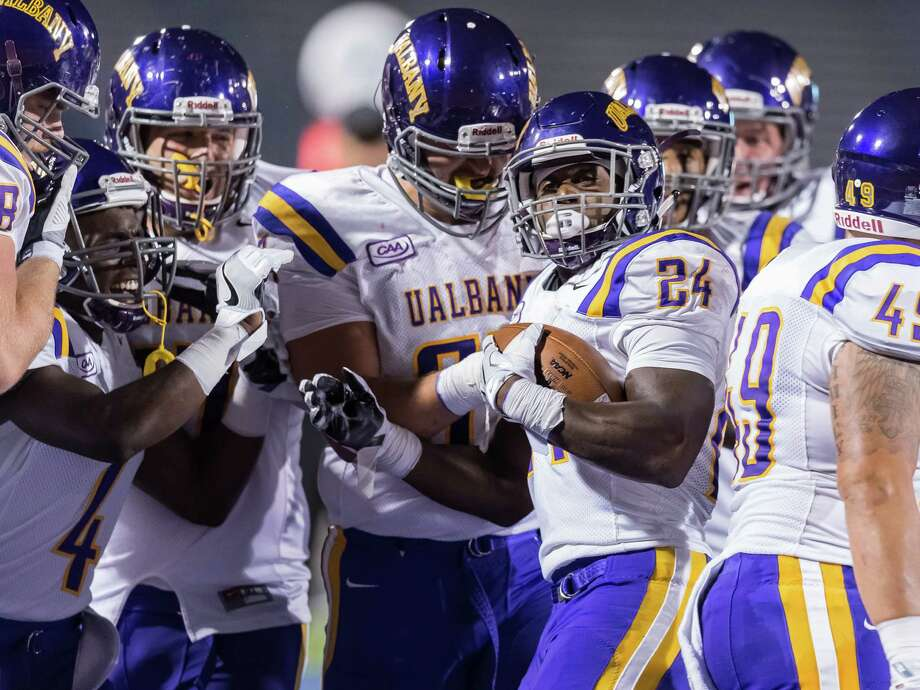 Elijah Ibitokun-Hanks celebrates with his teammates Friday during a win over Buffalo. (Bill Ziskin / University at Albany) Photo: Bill Ziskin / © Bill Ziskin Photography LLC