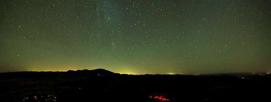 Davis Panorama The lights of 24-hour oil and gas operations in the Permian Basin have created a sky glow visible to the north of the McDonald Observatory in the Davis Mountains. The observatory and Pioneer Energy Services have been testing lighting that avoids sending light skyward and creates a safer job site by reducing glare. Image courtesy of the McDonald Observatory. Photo: Chase Fountain / Chase Fountain, TPWD ©2014