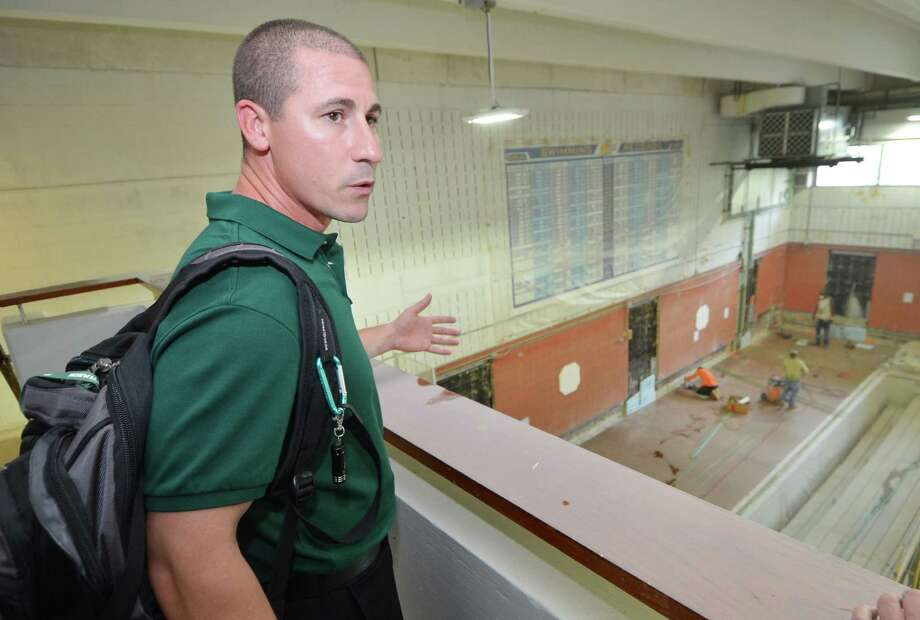 Norwalk High School boys swim coach Chris Passamano looks over the construction site that is the pool at the Spinola Natatorium at Norwalk High School. Photo: Alex Von Kleydorff / Hearst Connecticut Media / Connecticut Post