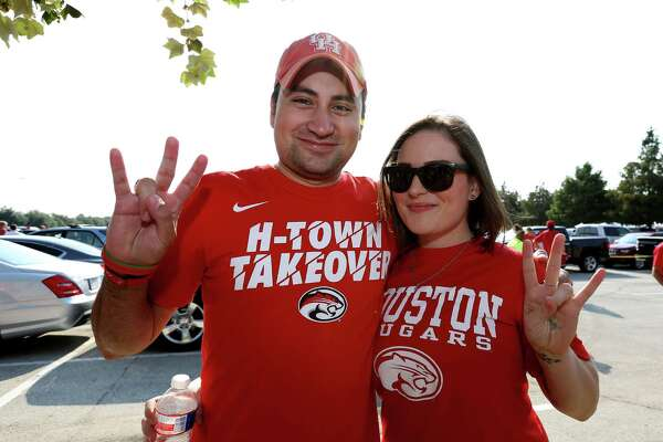 Fans pose for a photo before the University of Houston v.s. University of Oklahoma Advocare Texas Kickoff Game at NRG Stadium Saturday, Sept. 3, 2016, in Houston .