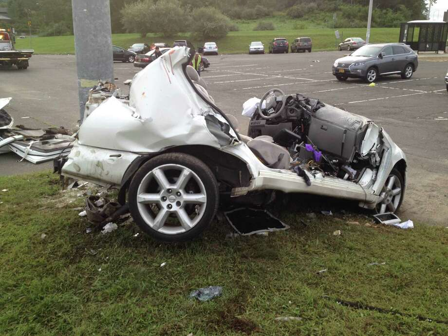 The remains of a Nissan Maxima that smashed into a utility pole early in the morning Saturday, Sept. 3, 2016. The crash killed three people. Photo: Contributed Photo / Contributed Photo