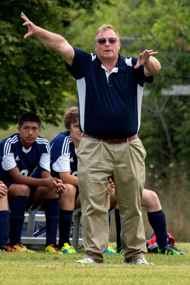 USA soccer coach Kevin Kuhl gives out instructions to his player during a game. Kuhl has been coaching soccer for 28 years and has put everything he has into the USA program. He helped shape the lives of countless athletes during his time, forming bonds which have lasted a lifetime.