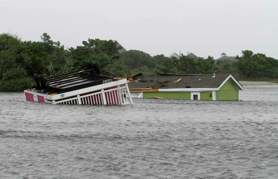 Two trailers sit overturned in the creek behind the Hatteras Sands Campground in Hatteras, N.C., Saturday, Sept. 3, 2016 after Tropical Storm Hermine passed the Outer Banks.  The storm is expected to dump several inches of rain in parts of coastal Virginia, Maryland, Delaware, New Jersey and New York as the Labor Day weekend continues. Photo: Tom Copeland, AP / Tom Copeland