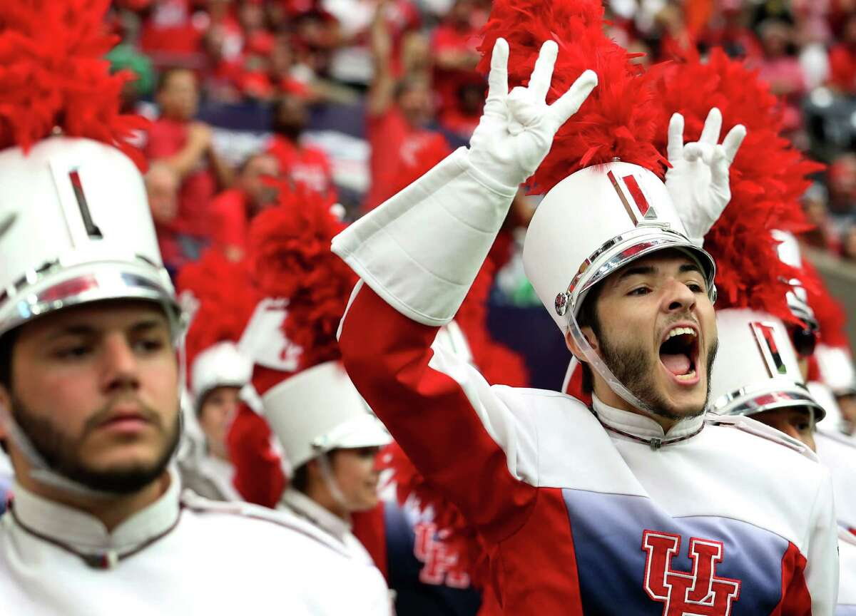 Spirit of Houston Marching Band member Michael Lomonte cheers for his team during the first half of the University of Houston v.s. University of Oklahoma Advocare Texas Kickoff Game at NRG Stadium Saturday, Sept. 3, 2016, in Houston .