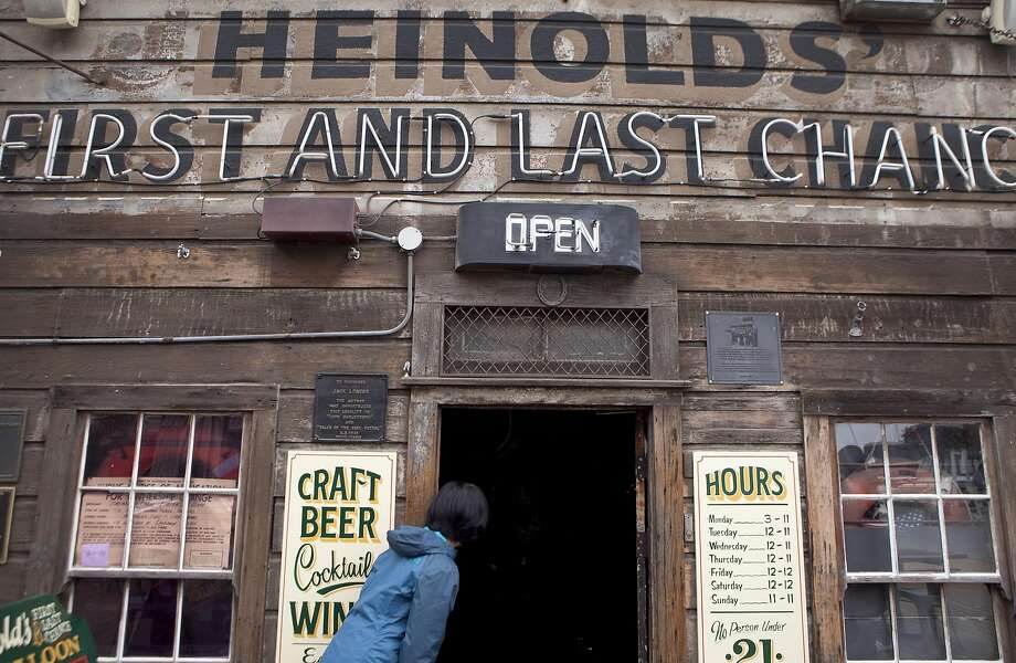 Sweeling Chen of Oakland peeks into Heinold's First and Last Chance Saloon during the Jack London Square Waterfront tour on Saturday, September 3,  2016 in Oakland. Photo: Gabriella Angotti-Jones, The Chronicle