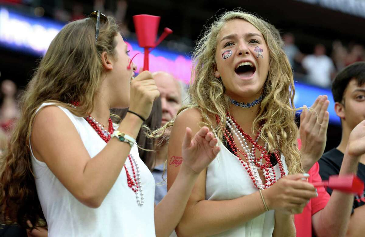 University of Houston football fans cheer for their team during the second half of the Advocare Texas Kickoff Game against University of Oklahoma at NRG Stadium Saturday, Sept. 3, 2016, in Houston . The Cougars won the game 33-23.