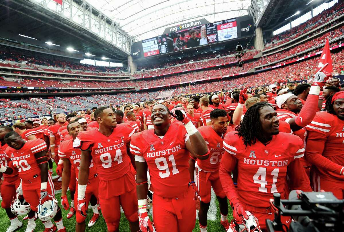 University of Houston football players celebrate with their fans after defeating University of Oklahoma at the Advocare Texas Kickoff Game at NRG Stadium Saturday, Sept. 3, 2016, in Houston . The Cougars won the game 33-23.
