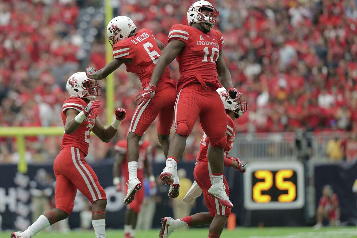 Houston's defense celebrates after stoping Oklahoma Sooners from converting a 4 and 16 situation in the fourth quarter during Advocare Texas Kickoff on Saturday, Sept. 3, 2016, at NRG Stadium in Houston. Houston won the game 33-23.