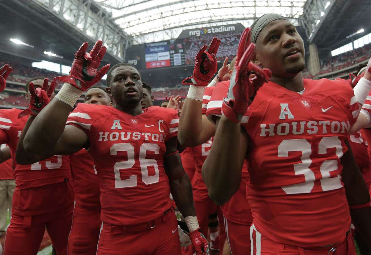 Houston Cougars sing the school's song after beating Oklahoma Sooners 33-23 in the Advocare Texas Kickoff on Saturday, Sept. 3, 2016, at NRG Stadium in Houston.