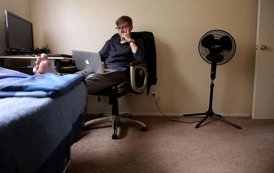UC Berkeley student Tyler Long has his own small bedroom in a two-bedroom apartment, but the living room is rented to a third student. Photo: Michael Macor, The Chronicle