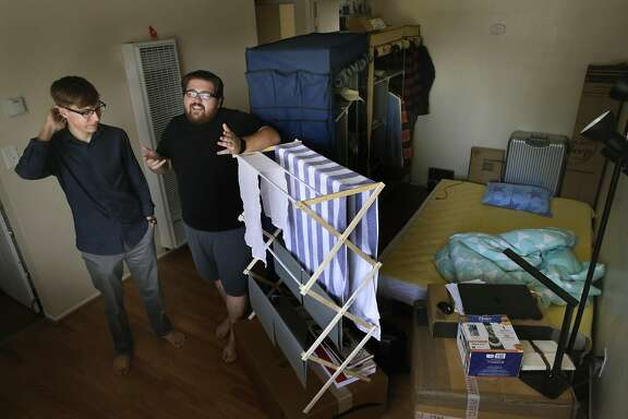 UC Berkeley students Tyler Long, (left) and Mikole De Laurentiis at their two bedroom apartment in Berkeley, Calif. on Sat. Sept. 3, 2016. With the steep prices for apartment rentals they added a third bedroom space in the living room that is currently rented out to cut down on their monthly rental costs.