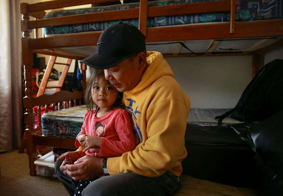Rommel Laguardia, 49, is strugggling to stay in the 400- square- foot Alameda apartment he shares with his 4-year-old daughter, Beatrice, plus his wife and two other children. Photo: Michael Macor, The Chronicle