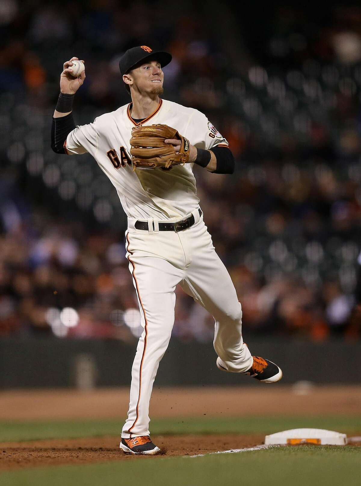 SAN FRANCISCO, CA - MAY 09: Matt Duffy #5 of the San Francisco Giants throws out Jose Bautista #19 of the Toronto Blue Jays in the ninth inning at AT&T Park on May 09, 2016 in San Francisco, California. (Photo by Ezra Shaw/Getty Images)