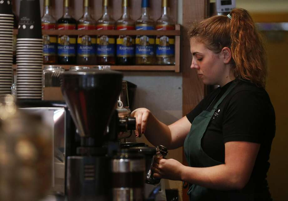 Employee Kaya Johnson prepares a hot drink at the Beanery in Berkeley. Photo: Leah Millis, The Chronicle