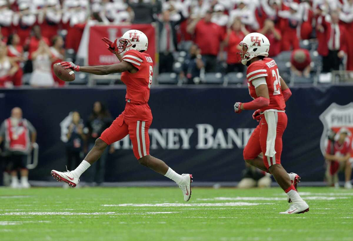 Houston Cougars cornerback Howard Wilson (6) celebrates with Houston Cougars safety Garrett Davis (1) after Wilson recovered a fumble against Oklahoma Sooners on Saturday, Sept. 3, 2016, at NRG Stadium in Houston.