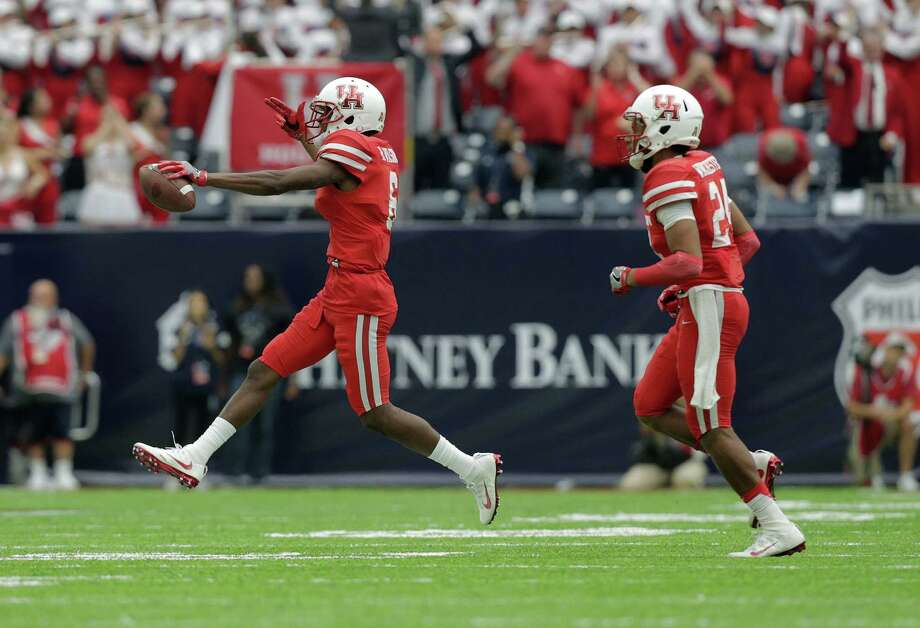 Houston Cougars cornerback Howard Wilson (6) celebrates with Houston Cougars safety Garrett Davis (1) after Wilson recovered a fumble against Oklahoma Sooners on Saturday, Sept. 3, 2016, at NRG Stadium in Houston. Photo: Elizabeth Conley, Houston Chronicle / © 2016 Houston Chronicle
