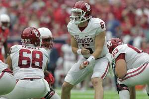 Oklahoma Sooners quarterback Baker Mayfield (6) shouts out plays to his team as the sound in NRG Stadium carries. University of Houston and Oklahoma University football teams play in the Advocare Texas Kickoff on Saturday, Sept. 3, 2016, at NRG Stadium in Houston.