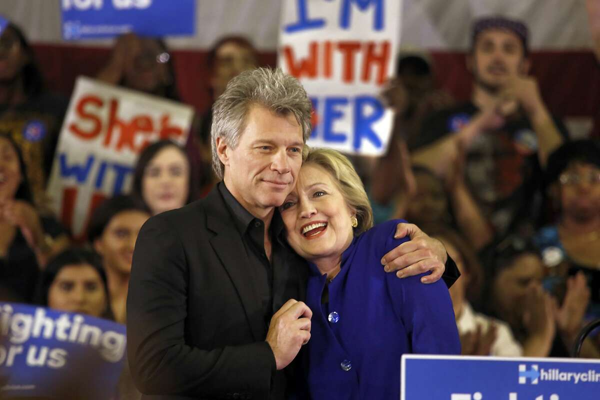 Democratic presidential candidate Hillary Clinton gets a hug from Jon Bon Jovi as she campaigns at the Golden Dome Athletic Center at Rutgers University Student Health in Newark, N.J., on June 1.
