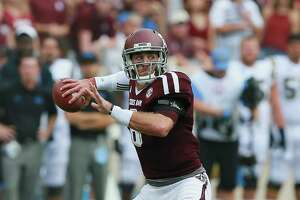 COLLEGE STATION, TX - SEPTEMBER 03:  Trevor Knight #8 of the Texas A&M Aggies looks for a receiver against the UCLA Bruins at Kyle Field on September 3, 2016 in College Station, Texas.