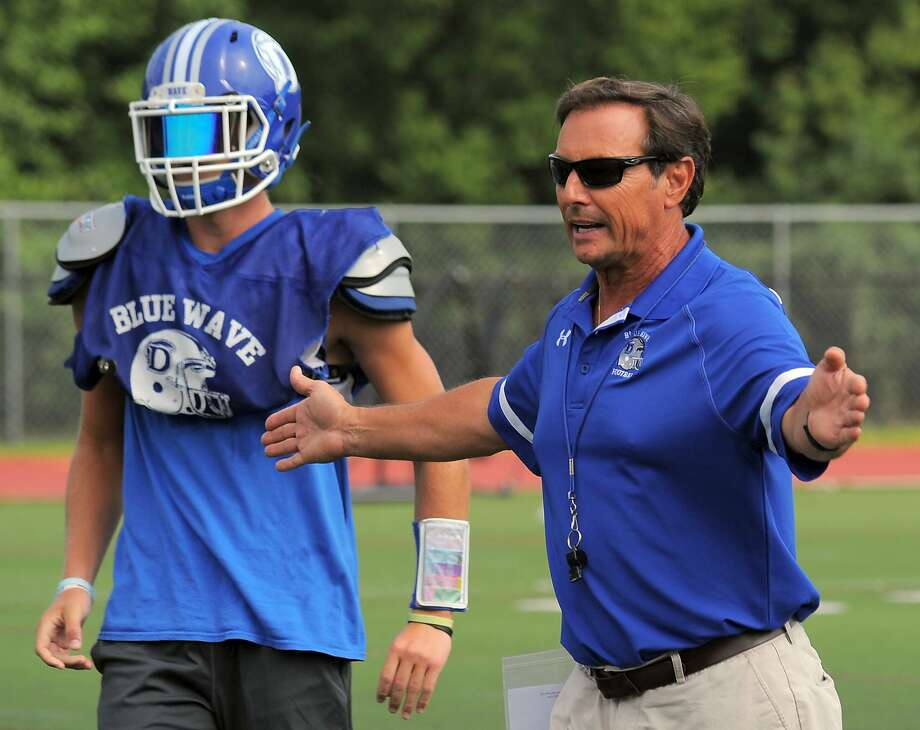Darien coach Rob Trifone talks with his players at a varsity football practice at the high school in Darien on Sept. 1, 2016.  Photo: Matthew Brown, Hearst Connecticut Media