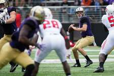 Washington quarterback Jake Browning looks for an open man in the first half of their season opener against Rutgers, in Seattle on Saturday, Sept. 3, 2016.