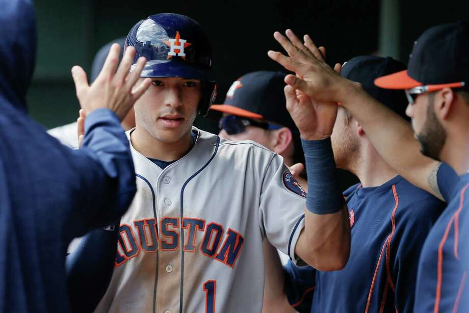 ARLINGTON, TX - SEPTEMBER 03: Carlos Correa #1 of the Houston Astros is congratulated by teammates after scoring on an RBI single hit by Teoscar Hernandez, not pictures, during the second inning of a baseball game against the Texas Rangers at Globe Life Park in Arlington on September 3, 2016 in Arlington, Texas. Photo: Brandon Wade, Getty Images / 2016 Getty Images