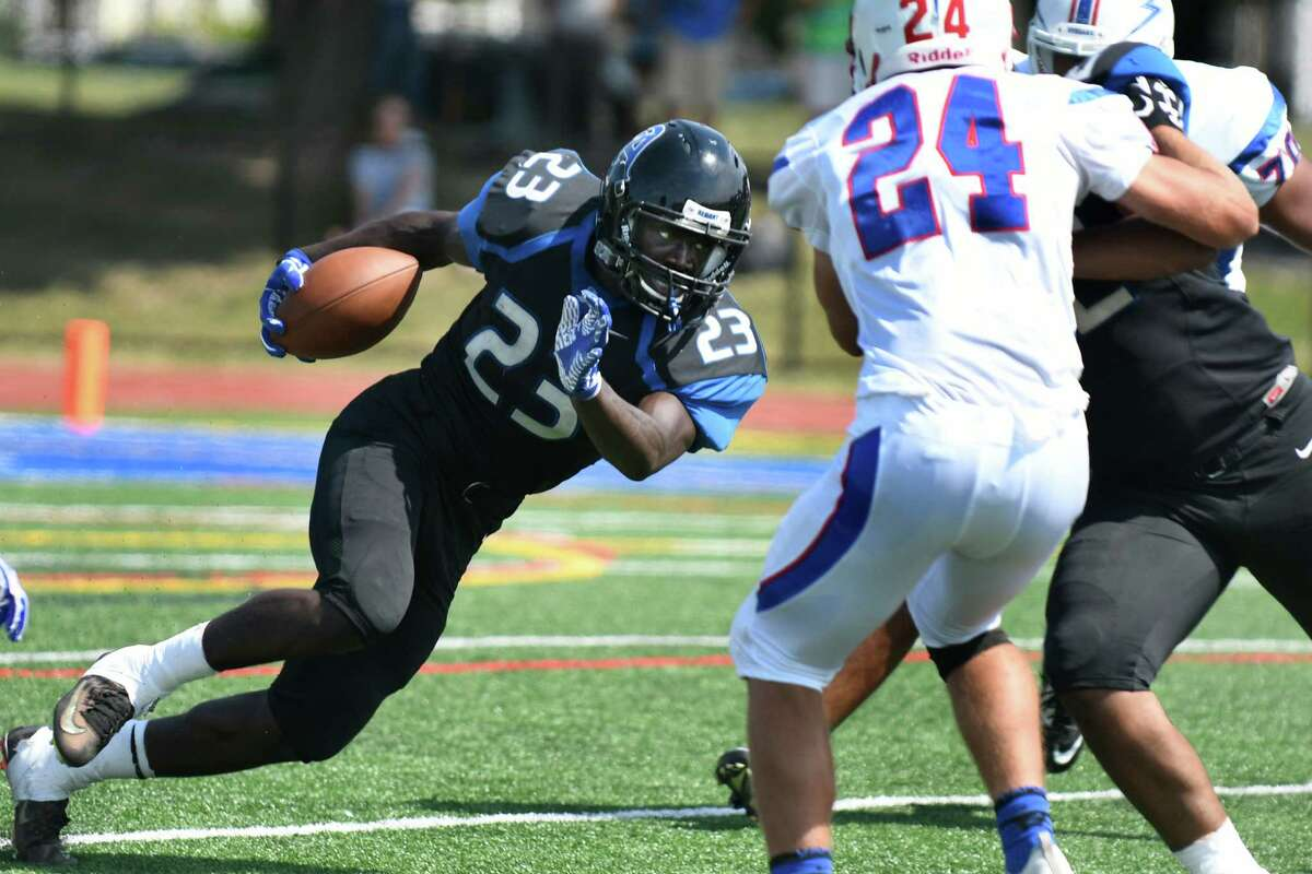 Albany's Ky'ere Tillery, left, charges into Saratoga defenders during their football game on Saturday, Sept. 3, 2016, at Albany High in Albany, N.Y. (Cindy Schultz / Times Union)